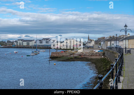 Irvine Harbour with some small craft moored and the town itself can be seen beyond the harbour. - Stock Photo