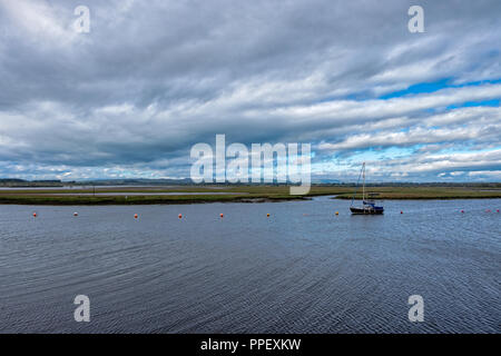 Single Yacht out on Irvine Bay in Scotland - Stock Photo