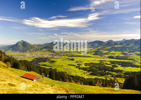 Panoramic landscape in Bavaria overlooking the Allgaeu and Sonthofen before the Gruenten mountain - Stock Photo
