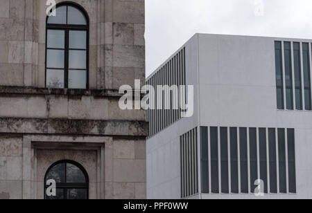 The new Documentation Centre for the History of National Socialism (right) in the Brienner Strasse, near the Koenigsplatz, on the left the Hochschule fuer Musik und Theater Muenchen (University of Music and Performing Arts Munich), the former Fuehrerbau. - Stock Photo