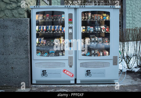 A vending machine with spare bicycle parts in the