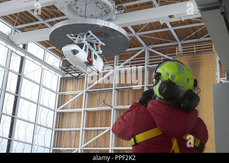 Air rescue training at the Bavarian Mountain Rescue Service in Bad Tolz. The picture shows a helicopter training course for a group from Italy. Bavaria, Germany - Stock Photo