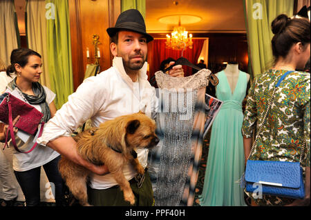 Fashion designer Kay Rainer with dog Emmi at the 'Buy My Dress' charity sale of dresses and accessories of celebrities at Hotel Bayerischer Hof in Munich in favor of the children's aid organization 'Children for a better World e.V.'. - Stock Photo
