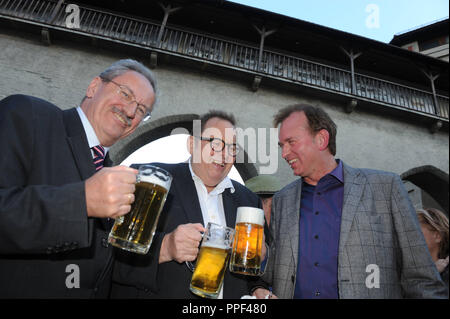 Mayor Christian Ude with actor Ottfried Fischer and comedian Christian Springer (from left) at the opening of the exhibition 'Der sanfte Bulle' in honor of Ottfried Fischer at the Valentin-Musaeum. - Stock Photo