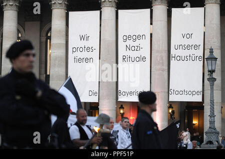 The State Opera and the Residenz Theater protest against a neo-Nazi march. The right-wing extremists commemorate the anniversary of the death of one of their comrades, Reinhold Elstner, who set himself on fire in 1995 to protest against the Wehrmacht exhibition. Above the entrance of the opera there are long white cloths bearing the inscription 'We protest against Nazi rituals at our doorstep - the Bavarian State Opera.' - Stock Photo
