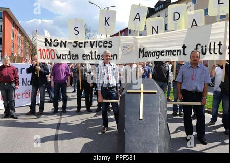 The Verdi union called for protest against the planned site closure during a staff meeting at Nokia Siemens Networks (NSN). The picture shows the participants of a protest march to the headquarters of the German-Finnish joint venture. - Stock Photo