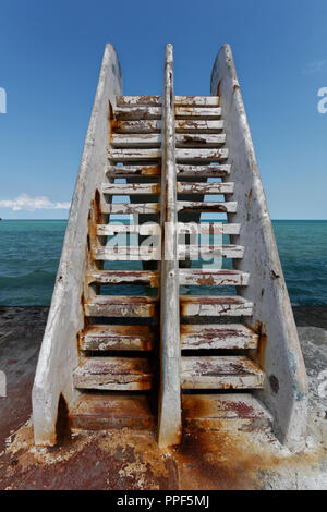 An old concrete slide in the seaside playground - Stock Photo