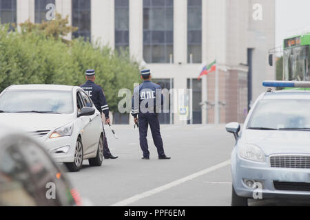 Kazan, Russia - 27 august 2018 - Russian officers of the road police service with striped wands watching the city road