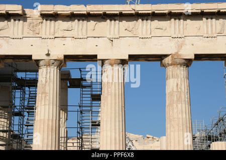 Greek Art. Parthenon. Was built between 447-438 BC. in Doric style under leadership of Pericles. The building was designed by the architects Ictinos and Callicrates. Detail of entablature (frieze with triglyphs and metopes, archirave, capital with abacus, echinus and necking, and columns. Acropolis. Athens. Attica. Central Greek. Europe. - Stock Photo
