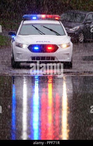 Laval,Canada,5 May,2017.Police car in the rain blocking traffic on street after a springtime flash flood.Credit:Mario Beauregard/Alamy Live News - Stock Photo