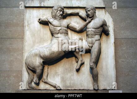 South metope XXXI from the Parthenon marbles depicting part of the battle between the Centaurs and Lapiths. 5th century BC. Athens. British Museum. London. United Kingdom. - Stock Photo