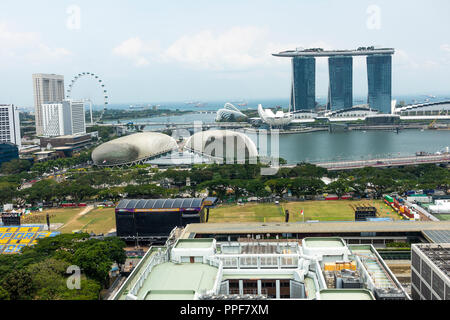 An Aerial View of The Padang with The Singapore Flyer, Marina Bay Sands Hotel, and The Esplanade Theatres in Republic of Singapore Asia - Stock Photo