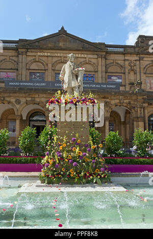 William Etty statue decorated with flowers for the Bloom Festival Exhibition Square York North Yorkshire England UK United Kingdom GB Great Britain - Stock Photo