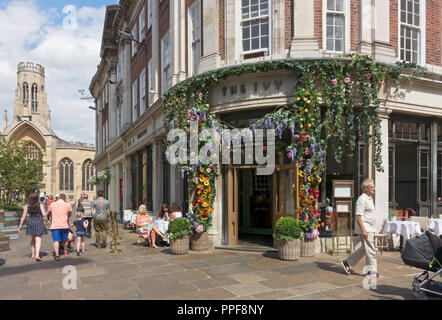 The Ivy restaurant decorated with flowers for the Bloom Festival St Helens Square York North Yorkshire England UK United Kingdom GB Great Britain - Stock Photo