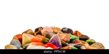 Pile of polished semi-precious gemstones with copy space. Isolated on white background. Close-up tumbled stones. - Stock Photo