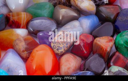 Close-up semi-precious stones background. Pileof polished gemstones. - Stock Photo