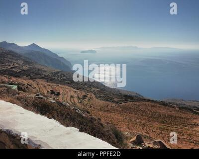 Greece, the island of Sikinos.  A magnificent view from the high hills to the Aegean sea below. - Stock Photo
