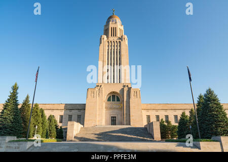 Exterior of the Nebraska Capitol Building in Lincoln against a blue sky - Stock Photo