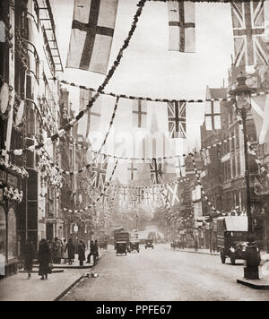 Flags and bunting hanging in Fleet Street, London to celebrate the 1935 Jubilee, St. Paul's cathedral in the distance.  From These Tremendous Years, published 1938. - Stock Photo