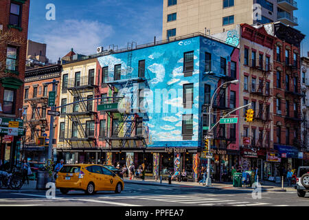 Artistic east village with graffiti in NYC Manhattan with people and traffic - Stock Photo