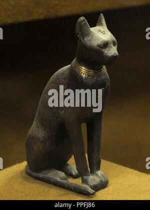 Bronze statue of the goddess Bastet represented as a domesticated cat. The State Hermitage Museum. Saint Petersburg. Russia. - Stock Photo