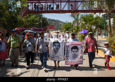 Parents of missing students take part in a march in Tlapa, Guerrero, Mexico, held in support of 43 missing students from Guerrero State that have been unaccounted for almost two months, on November 15, 2014. The march was the start of a number of caravans that will be traveling around Mexico for a week and meeting in Mexico City on November 20, which is the marker of Mexico's Revolution. - Stock Photo