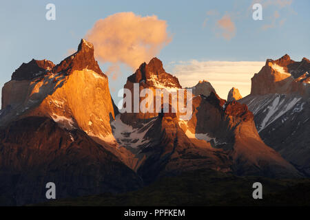 Los Cuernos del Paine, mountain range at sunrise on Lake Pehoe, Torres del Paine National Park, Patagonia, Chile - Stock Photo