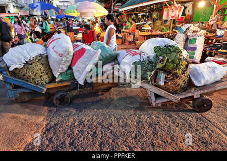 Cebu, Philippines-October 18, 2016: Porters take a break while carrying vegetables on carts. Carbon Market-oldest and largest farmer's market in town- - Stock Photo