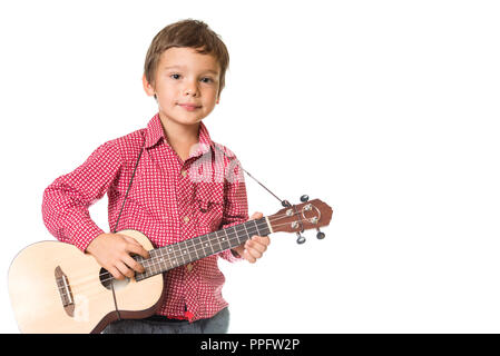 young adorable boy playing the ukulele, isolated on white background with space for text - Stock Photo
