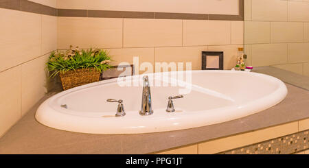 Sparkling white sink of a clean bathroom - Stock Photo
