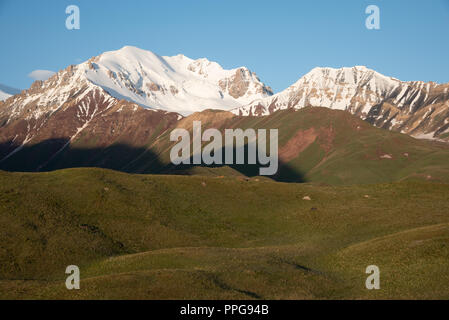sunrise over Peak Lenin valley, Kyrgyzstan - Stock Photo