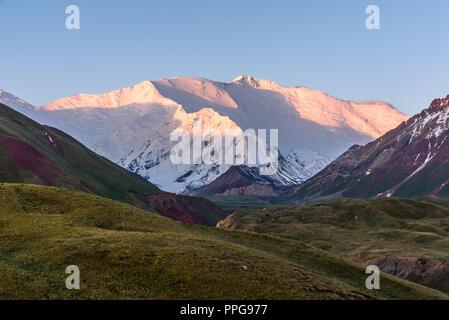 sunrise over Peak Lenin, Kyrgyzstan - Stock Photo