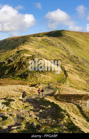 Fell Walkers on the path leading to the summit of Harter Fell from Mardale Ill Bell in the Lake District National Park, Cumbria, England. - Stock Photo