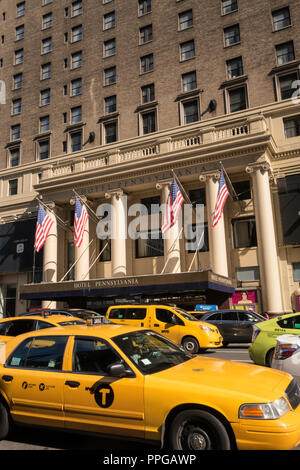 Pennsylvania Hotel on Seventh Avenue with Taxis in Foreground, NYC, USA - Stock Photo