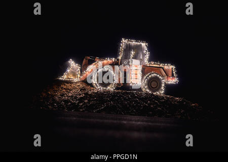 Blurred wheel loader decorated with lights - Stock Photo