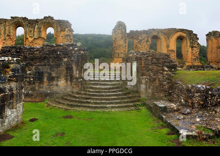 Byland Abbey on a wet murky day with low cloud in North Yorkshire - Stock Photo