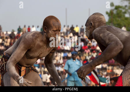 Sunday 5 december 2010 - Juba, Southern Sudan - Traditional wrestling matches in Juba Stadium between Dinka wrestlers from Yirol East of Lake State and Mundari wrestlers from Terekeka County of Central Equatoria State. The matches attracted large numbers of spectators who sang, played drums and danced in support of their favorite wrestlers. The match organizers hoped that the sport would bring together South Sudan's many different tribes.Photo credit: Benedicte Desrus - Stock Photo