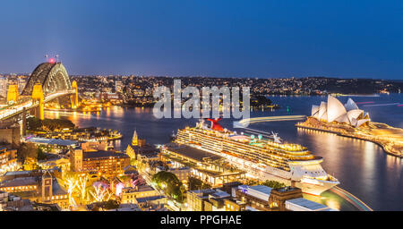 Sydney Harbour Bridge and Sydney opera House with the Carnival Spirit Cruise Ship docked at the Overseas Passenger Terminal. Australia - Stock Photo