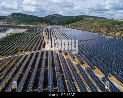 Huzhou. 26th Sep, 2018. Aerial photo taken on Sept. 26, 2018 shows a photovoltaic power station built on the site of an abandoned mine in Donghong Village of Huzhou City, east China's Zhejiang Province. Credit: Xu Yu/Xinhua/Alamy Live News - Stock Photo