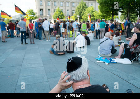 09 June 2018, Berlin: During a rally in front of the Federal Chancellery, a man wears a kippa with a Star of David after the so-called 'Frauenmarsch 2.0'. The event was organized by right-wing populist groups from the AfD environment. Jewish members of the AfD want to found a nationwide association on October 7 in Offenbach, Hesse. Founding member Dimitri Schulz wrote to the German Press Agency 'The AfD is the only party of the Federal Republic that (...) addresses Muslim hatred of Jews without trivializing it'. Photo: Stefan Jaitner/dpa - Stock Photo