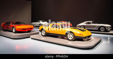25 September 2018, North Rhine-Westphalia, Duesseldorf: A Mercedes-Benz C111 Type II Concept Auto (r) and a BMW Turbo (l) are on display with other sports cars in the exhibition 'PS: I love you' at the Museum Kunstpalast. In the exhibition about 30 sports cars of the 1950s to 1970s can be seen from 27.09.2018 to 10.02.2019. Photo: Christophe Gateau/dpa - Stock Photo