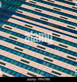 Windows of under construction high-rise building. Front view of modern glass and concrete exterior of high rise building as abstract background - Stock Photo