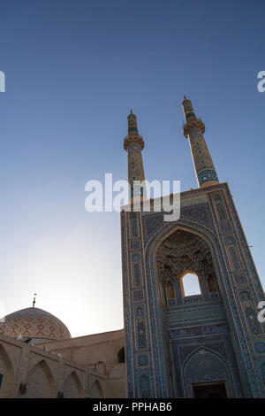 Jameh mosque, with its distinctive tiles minarets, seen at sunset. Jameh mosque is one of the symbols of the city of Yazd, in the middle of the desert - Stock Photo