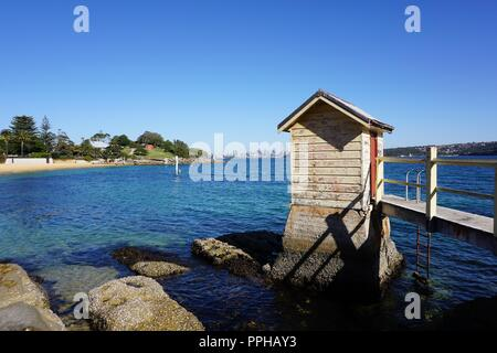 Disused Camp Cove Pier with Sydney's Skyline in the Distance - Stock Photo