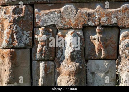 close up of Eflatun Pınar ( Eflatunpınar) Ancient Hittite relief sculpture monument and sacred pool, and its Hittite relief scultures of Hittite gods. - Stock Photo