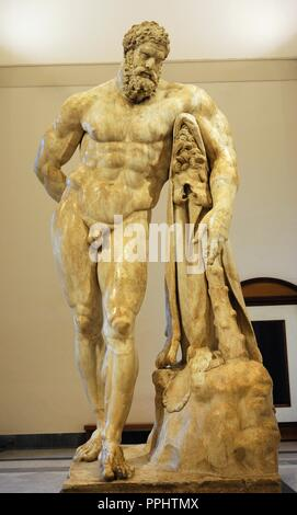Hercules at rest or Farnese Hercules. Roman copy, end 2nd-early 3rd centuries Ad, from a Greek original of second half 4th century BC. From baths of Caracalla, Rome. National Archaeological Museum, Naples. Italy. - Stock Photo