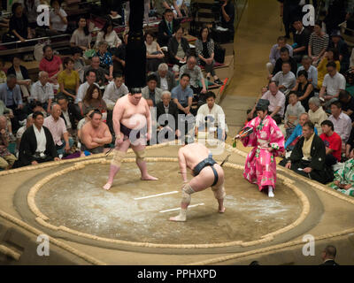 Tokyo, Japan. September 9, 2018. : Judge and sumo wrestlers in the Tokyo Grand Sumo Tournament in 2018. - Stock Photo