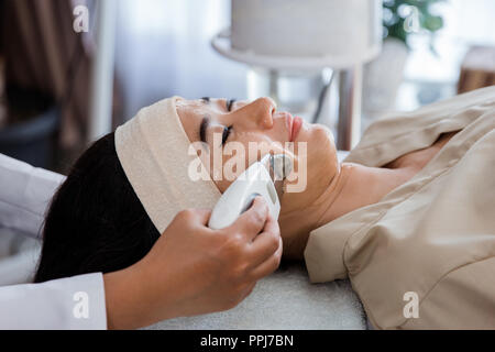 Picture of beautician doing rf procedure - Stock Photo