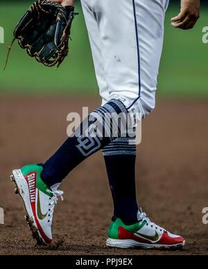 spikes de Christian Villanueva con los colores y la bandera de mexico.  Baseball action during the Los Angeles Dodgers game against San Diego Padres,  - Stock Photo