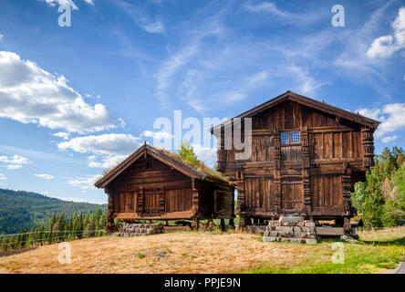 Old traditional Norwegian Stabbur elevated wooden store houses Telemark, Norway, Scandanavia - Stock Photo